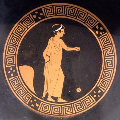 Muchacho jugando con un yo-yo de terracota, en un kylix griego, hacia el 440 a. C. Museo Antikensammlung (Berlín).